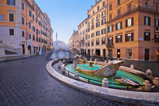 Piazza di Spagna square and Fontana della Barcaccia fountain in Rome morning view