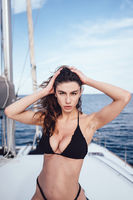Fashion outdoor photo of beautiful young woman posing on a yachts