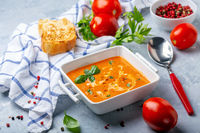 Tomato soup with green basil.