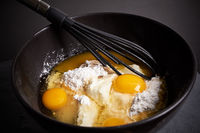 Mixing Bowl and Whisk with Eggs, Flour and Sugar