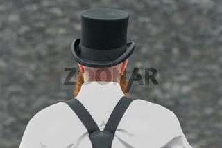 Rear view of a man wearing vintage fashion