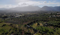 Aerial photo Campanet town situated in the northeast of Palma de Majorca, agricultural fields and meadows countryside rural scene, Balearic Islands, Spain