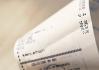 Close-up view of the total amount of supermarket grocery shopping printed on a paper receipt