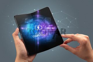 Businessman holding a foldable smartphone, technology concept