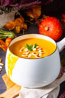 Pumpkin cream soup with roasted pumpkin seeds and seed oil