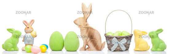 Traditional Easter holiday bunny and eggs on white background