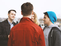 group of teenage friends talking and laughing together