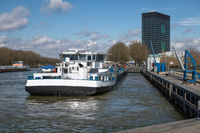 Dutch Amsterdam-Rijn canal with ship mooring at oil transit point