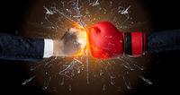 Fighting hands breaking glass