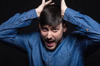 Alluring man screaming posing in studio