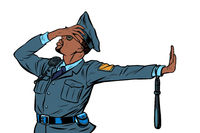 african Police officer. Gesture of denial, shame