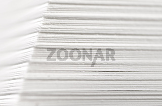 white paper stack closeup with shallow depth of field DOF