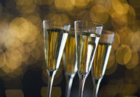 Champagne glasses on lights background. Christmas background