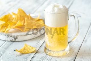 Mug of beer with tortilla chips