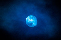 a blue full moon with clouds in february 2019