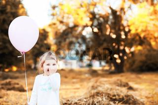 Little children are walking in autumn park