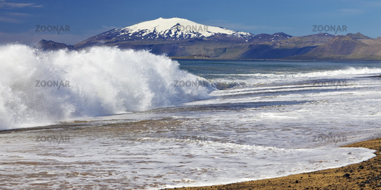 Beach with surf, behind snow covered volcano and glacier Snæfellsjökull, Snæfellsnes, Iceland Europe