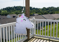 White unicorn shaped pinata after being beaten at childs party