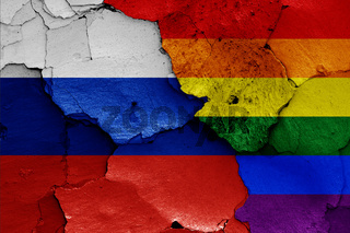 flags of Russia and LGBT painted on cracked wall