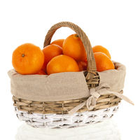Wicker basket full with clementines