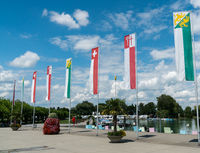 flags and banners of Switzerland and Thurgau and Kreuzlingen in the harbor at Kreuzlingen