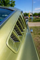 Ventilation grille of pony car Ford Mustang (first generation), close-up.