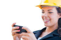 Female Contractor In Hard Hat Using Smart Phone Isolated On White