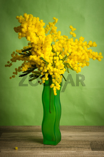 Spring bouquet with mimosa and tulips in a vase