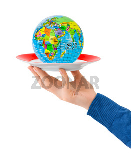 Hand with plate and globe