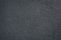 black wall roughcast plaster background texture