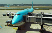 Boeing 747-8i of Korean Air with two passenger boarding bridges, Seoul, South Korea