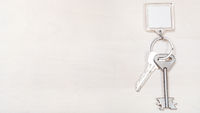keys on keyring with blank white keychain on board