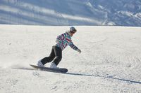 Female snowboarder on the slope
