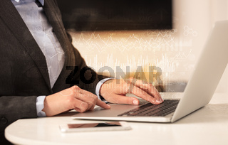 Business woman working on laptop with global financial report concept