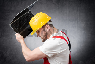 Construction worker with laptop