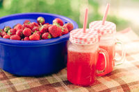 Homemade strawberry lemonade in glasses. Summer cold refreshing drink. Drink in nature. Strawberry berry and carbonated drink