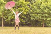 Happy girl with umbrella having fun