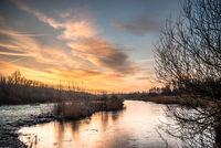 Frozen river morning sky