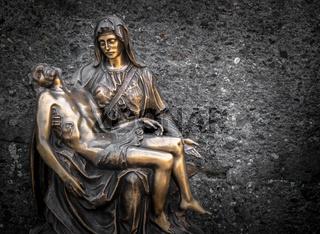 Religious bronze statue representing the piety of Michelangelo