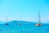 Yachts in the sea on the summer day