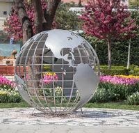 Little model globe made of metal in garden