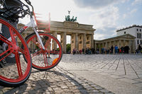 Bicycles of the Chinese company Mobike in front of the Brandenburg Gate in Berlin