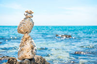 Zen stones balance at sea background