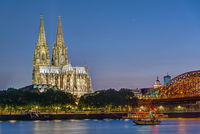 The famous Cologne Cathedral and the river Rhine at night