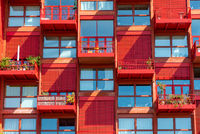 Facade of a red apartment house seen in Berlin, Germany