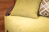 Close-up handle armrest textile red sofa. New furniture. Shallow depth of field