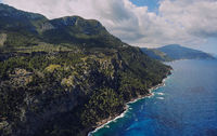 Picturesque aerial photo of rocky coastline of Son Marroig in the Palma de Mallorca touristic famous island, beautiful place Mediterranean sea cloudy sky at sunny summer day, Spain