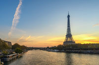 Paris France city skyline sunrise at Eiffel Tower and Seine River