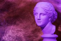 Gypsum copy of ancient statue Venus head on a textured background. Plaster sculpture woman face.