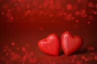 Red hearts on glitter background